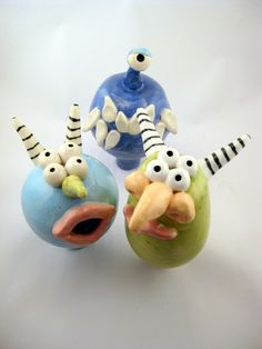 """These """"Monsters on a Stick"""" were designed by Kersten Fuith (Etsy) as decorations for garden stakes. They would be great pinch pot projects ideas for elementary students."""
