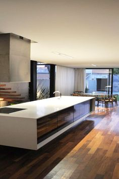A modern, clean lined kitchen ( We once contemplated a house on the Lake. I thought a sleek modern interior would be low maintenance for a second home. That was a departure thought for a traditionalist. But, it made sense for a working woman. G.S.):