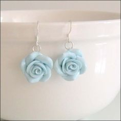 Polymer clay roses... How does she get those hooks in without breaking the flower?!