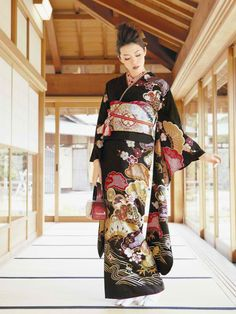 Japanese kimono. Look at the lovely balance of strong colors against the black -- it is a work of art that beautifully complements the model's face and hair.