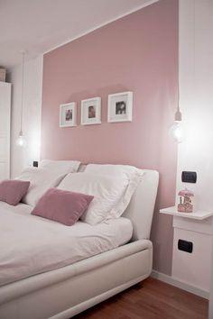 RELOOKING DI UN APPARTAMENTO CON SOPPALCO: Camera da letto in stile in stile Moderno di Laura Lucente Architetto