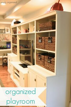 Organized playroom with PB built in shelves and storage cabinets, baskets to organize toys, and DIY chalkboard labels.  Streamlined and gorgeous! by Simply Organized  From Operation : Organization 2014 at 11 Magnolia Lane
