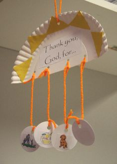 Hanging paper plate to show different things we thank God for.