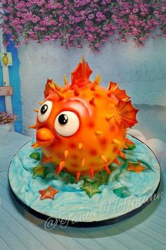 I made this puffer fish for my grandsons birthday. Its an sphere cake on a board. I fell in love with it by the time I was finished Lol. My grandson loved it :-) Cake inspiration- Paul Bradford. Mini Tortillas, Cupcakes, Cupcake Cakes, Food Design, Marine Cake, Chocolate Pinata, Fish Cake Birthday, Pinata Cake, Sea Cakes