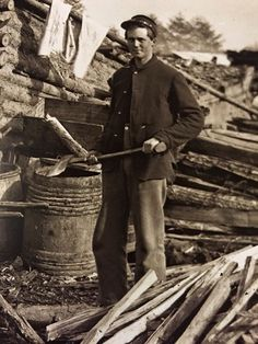 Camp Mess: A Union soldier in front of his mud-daubed log cookhouse in winter quarters near Falls Church, Virginia, in 1863.