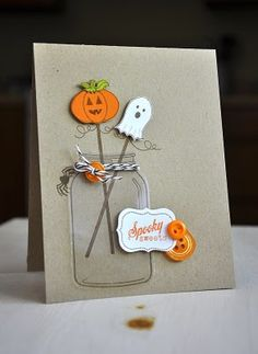 Acetate paper in the shape of a jar, placed on top of a stamped image of the jar, gives this handmade Halloween card a realistic touch.