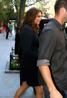 Escort: Caitlyn was accompanied by a bodyguard to keep her fans at bay
