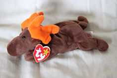 Check out this item in my Etsy shop https://www.etsy.com/listing/239091563/ty-chocolate-beanie-baby-original-beanie