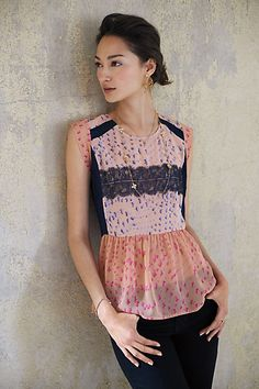 a pretty peplum top with a twist, via @Anthropologie. love the sheer and lace details.