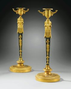 A PAIR OF PATINATED AND GILT-BRONZE CANDLESTICKS, EMPIRE.
