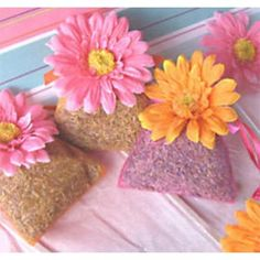 These trendy Gerber Daisy Lavender Sachets are perfect for any event! Each handmade sachet is filled with a fresh French lavender fragrance. These sachets are adorned with a silk gerber daisy. Color selection comes in your choice of a pink or tangerine flower on a pink or orange sachet. You may mix and match colors, choose the same colors, or choose to get them assorted.