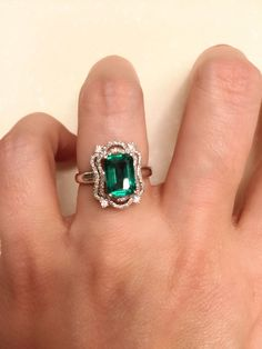 Stunning vivid green emerald and diamond ring