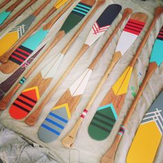 Canoe paddles by NORQUAY Co. Inspiration for painting oars. More ideas for painted #oars on Completely Coastal here: http://www.completely-coastal.com/2011/03/painted-oars-diy-or-buy.html