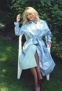 Relaxing in her pale blue pvc mac