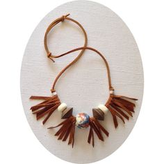 Den  Delve necklace in leather cord, repurposed hand-cut leather fringe, with unique, large scale vintage beads of wood and handmade ceramic.