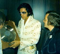"""Before his matinee show at the Nassau Coliseum, Uniondale (Long Island, NY) on June 24, 1973 - In the photos are members of the Norwegian Fan Club, """"Flaming Star"""", presenting Elvis with the Norwegian silver record for She's Not You/Just Tell Her Jim Said Hello and Aloha From Hawaii. Members of the group included Fan club President Pål Granlund, Erik Lorentzen and artist Per """"Elvis"""" Granberg"""