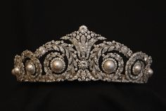A fabulous Cartier tiara, made for Ena in 1920. Designed as a series of laurel leaf scrolls, each one with a large button pearl, and a central motif of  fleur de lys.