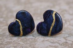 Kintsugi style broken heart stud earrings in swirled purple and black polymer clay with gold repair by AKintsugiLife