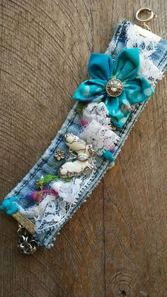 One of a kind hand made Blue Jean Cuff Bracelet with lace, hand made material flower, silver beads with a silver/white butterfly