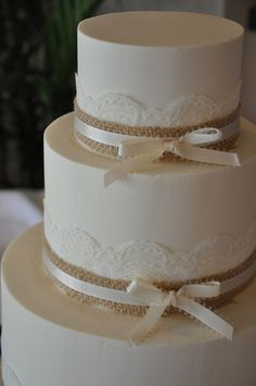 lace and burlap wedding cake would be cute with yellow lace and blue ribbon