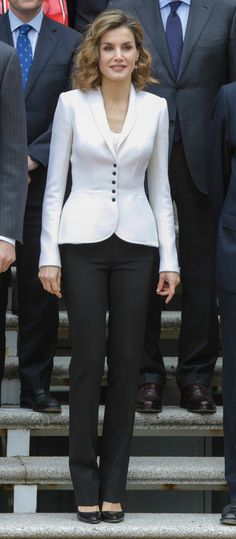 Queen Letizia attends a meeting for Cervantes IV Centenary on April 14, 2016 in Madrid, Spain. For the occasion, Doña Letizia opted for a chic corporate look, pairing a white blazer with black straight leg trousers.