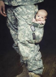 Soldier Has His Little Baby In his Pocket  --adorable!
