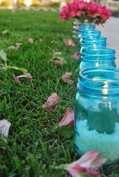 Inexpensive decor for outdoor entertaining using mason jars! So pretty!