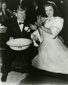Mickey Rooney & Judy Garland at Grauman's Chinese Theatre (The looks on their faces, omg)