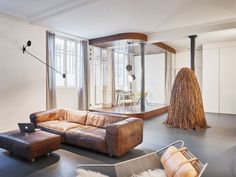 spread over two floors, the spacious wood and walnut loft uses materiality to establish a continuity throughout the renovation.