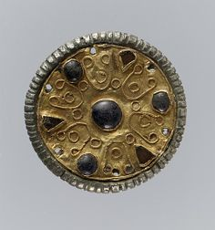 7th C. Disk Brooch old, wire, glass paste cabochons, copper alloy core, tinned bronze, iron pin Dimensions: Overall: 1 3/8 x 7/16 in. (3.5 x 1.1 cm)