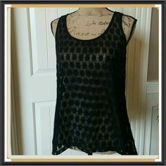Peekaboo I see you see through black top So fun and playful is this black see through top. Pull over style. Hem goes lower in the back. Beautiful cond. Never worn. Nylon Mossimo Supply Co Tops