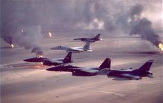 U.S. war planes flying over burning oil wells during Desert Storm, 1991