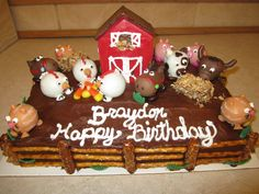 Barn Yard Cake. Decorated with cake pops. The barn is all chocolate as well with a candy bar roof. Draw out the pattern on wax paper and build your barn. Hay is a mini chocolate bar covered in toasted coconut.