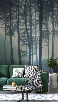 Discover calming interior design with a moody forest wallpaper. Featuring a sea of trees in deep misty hues, this wallpaper can transform any room into a serene hideaway. Display on a tall wall to feel the maximum impact of this mysterious mural. #topinteriordesigntips