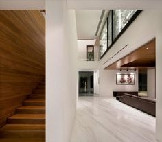 wooden-stairscase-also-wooden-wall-with-sede-living-room-interior-viw-with-good-lighting.jpg