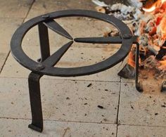 """Handforged by our local blacksmith, these trivets are perfect for raising your pots and kettles up over embers. 8"""" in diameter and 4-1/2"""" high. Based on an example found in Neuwmann`s Early American Antique Country Furnishings page 184."""