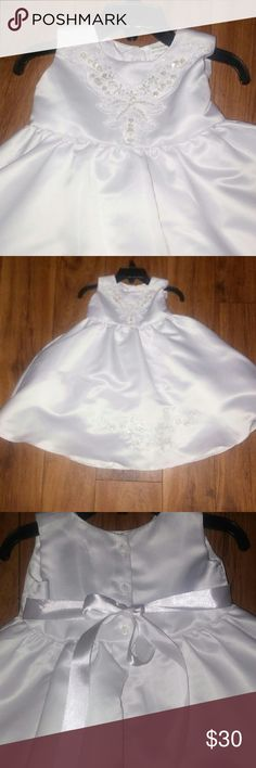 Almost new white girls Baptism or Wedding Dress Almost new white Baby dress, use for pictures only,very cute sequin details in the top & in the bottom of the skirt,sadly the Party postpose and by the time the Party was the baby did not fit on it anymore so its Practically new, whit out tags Dresses Formal