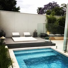 Our daybed keeping cool by the pool.  #cool #outdoorlife #outdoors #poolside #pool #daybed #outdoorliving #work #home #madeinmelbourne #lifestyle #melbourne #designer #melbournemade #backyard #australianmade #australia #white #custommade #style #outdoor #upholstery #life