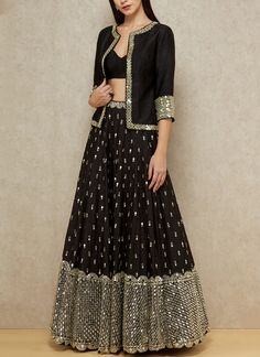 Abhinav Mishra's regal and luxurious creation is an ideal outfit for sangeet featuring a black bralette layered with an embellished jacket, paired with a mirror embellished lehenga. Style the look with mirrored chandbalis and juttis. Indian Fashion Dresses, Indian Gowns Dresses, Dress Indian Style, Indian Designer Outfits, Indian Outfits, Half Saree Designs, Choli Designs, Lehenga Designs, Raw Silk Lehenga