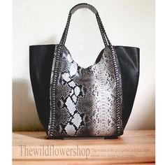 Kylie Faux Python Skin Tote  Get carried away! Travelling in style is easy with this gorgeous piece. Snap closure with luxurious chain strapes. Perfect for the fashionable and chic girl on the go!  • Faux PU leather cover  • Inclusive of small pouch  • Snap button closure  Material: PU Leather  $ 54
