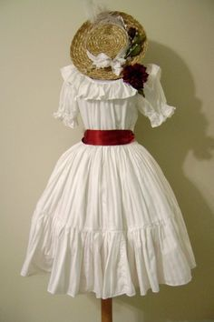 Cute, classic lolita: Off white dress. Red ribbon. Straw hat with flowers.