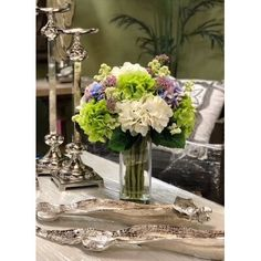 null Featuring faux hydrangeas and lavender in a classic glass vase, this charming arrangement offers garden-inspired style for your entryway or living room. Hydrangea Vase, Peonies And Hydrangeas, Hydrangea Not Blooming, Silk Floral Arrangements, Lavender Centerpieces, Floral Centerpieces, Vases Decor, Flower Spray, Faux Flowers