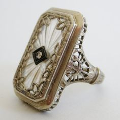 Vintage Antique Art Deco Fine 14k White Gold Filigree Camphor Glass Diamond Ring for sale by ParkBlvdEmporium on Etsy.  Via Diamonds in the Library.