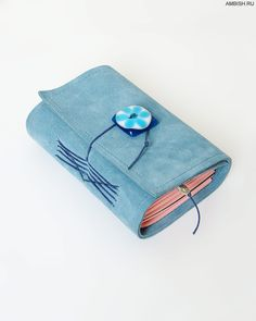 Handmade book by Lisalena (Блокнот). Small blue notebook from genuine suede with decorative buttons handmade. In notepad, 5 blocks in 34 unruled sheet in each separated by a beautiful handmade paper from India.