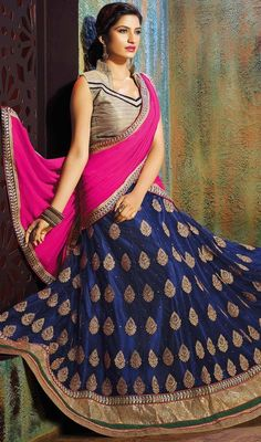 Attain an impression of elegance with this navy blue color embroidered silk and chiffon lehenga choli. Beautified with lace, resham with stone work. Upon request we can make round front/back neck and short 6 inches sleeves regular lehenga blouse also. #attractivelooklehengacholi #chaniyacholi #buttaworklehengacholi