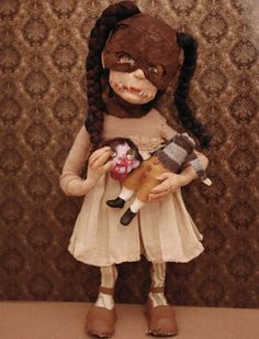 Very creepy dolls. I love the headless doll she's holding.