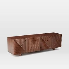 Love the Deco-ish geometric pattern in the wood on this media console, and closed cabinets can hide board games and other extras.  (Would also look great painted in glossy black, white, or antiqued gold.  Rosanna Ceravolo Media Console #westelm