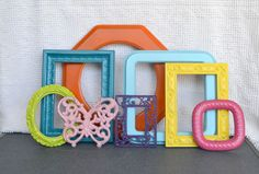 Bright Painted Funky Frames Set of 7 plus butterfly - Upcycled painted frames..  Gallery Wall/Cottage Playroom Teen Girl Kids Bedroom. $55.00, via Etsy.