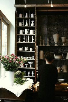 Freshen Your Home for the New Year | kitchen shelf styling | Love this sophisticated dark European - somewhat rustic kitchen with open shelves and a lovely collection of white ceramic pieces