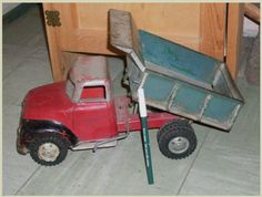 "from Toy Collector's ESTATE _Toys _ 1940'S FORD _13 "" Widest _Tonka Toys _Dump Truck Lever for the Whole Box and with ""Cool"" Dump Lever that opens + locks Dump Gate. Rubber Wheels. STRONG Construction. TONKA Toys U.S.A. $225.00 on GoAntiques. #vintage #antique #toy #tonka"